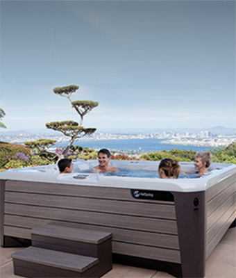 people in the hot tub with a city view